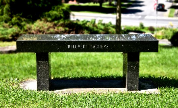A lovely bench monument with custom etch work.